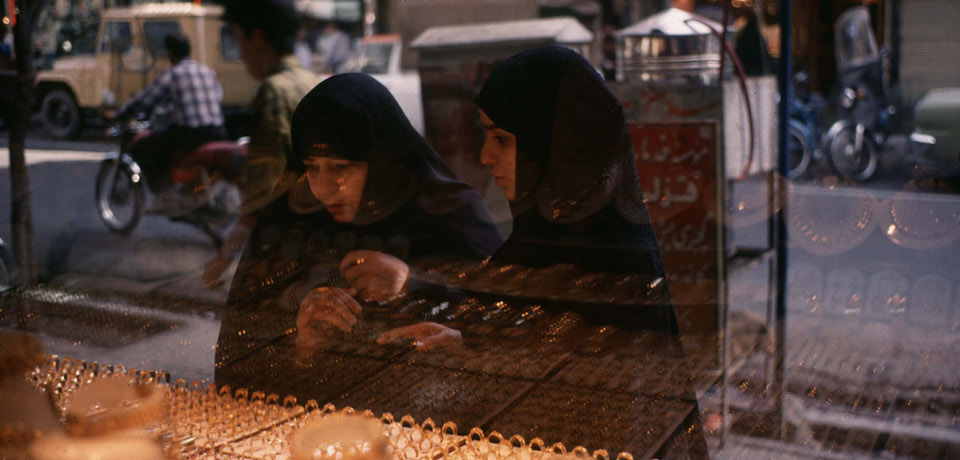 Tehran, Iran: Two chador clad women watch jewelery displayed in a shop window in a central Tehran street near the main bazaar. (Photo by Kaveh Kazemi/Getty Images)